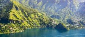 View of San Marcos La Laguna and surrounding mountains in Lake Atitlan, Guatemala. Hikes in Lake Atitlan, Guatemala.