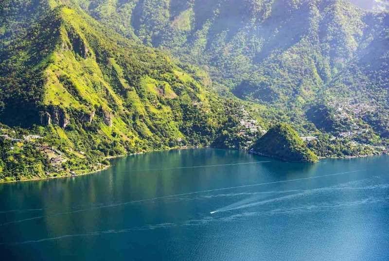 Lake Atitlan mountainous shoreline with a view of San Marcos La Laguna. Central America Tours