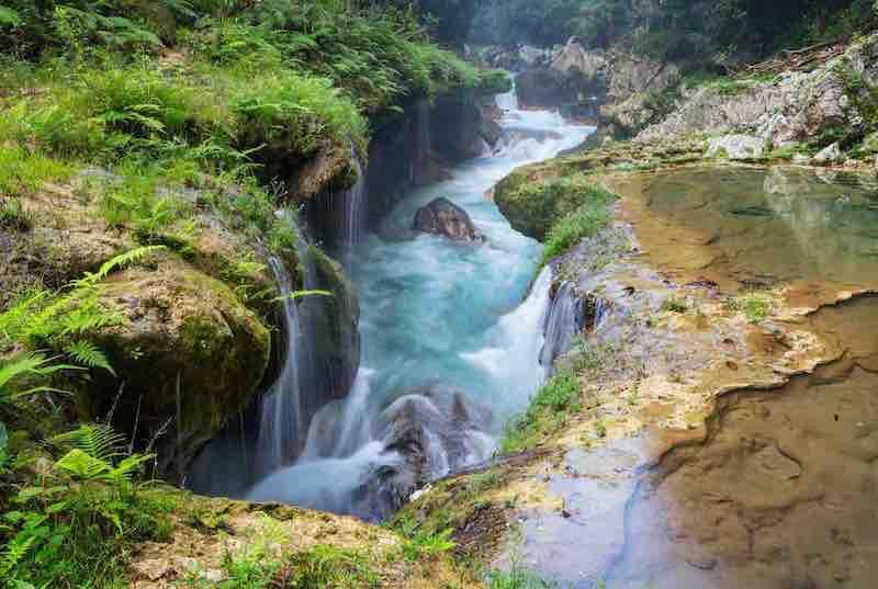 El Sumidero in the limestone bridge of Semuc Champey. Guatemala Ecotour
