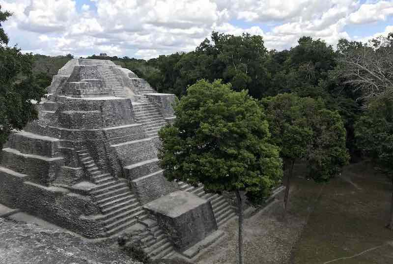 Temple in the Mayan ruins of Yaxha with surrounding jungle. Guatemala Tour Packages. Central America Travel Agency