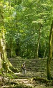 Woman alone exploring ancient Mayan Cities. Guatemala.