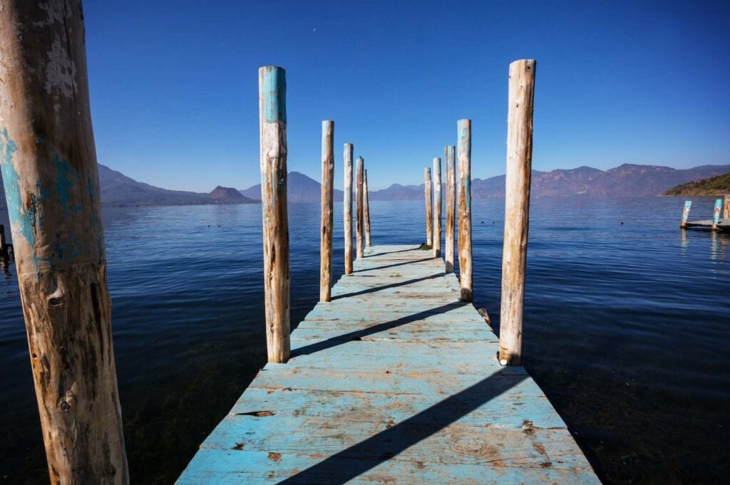 Beautiful lake Atitlan and volcanos in the highlands. Wellness Holiday in Guatemala