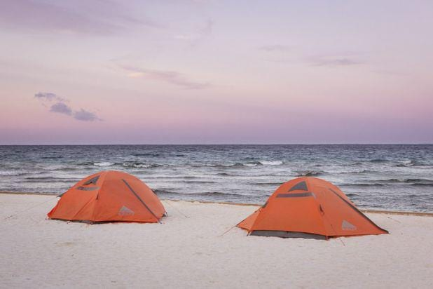 Camping in the beautiful little island of rendezvous Caye in Belize. Overnight Sailing in Belize