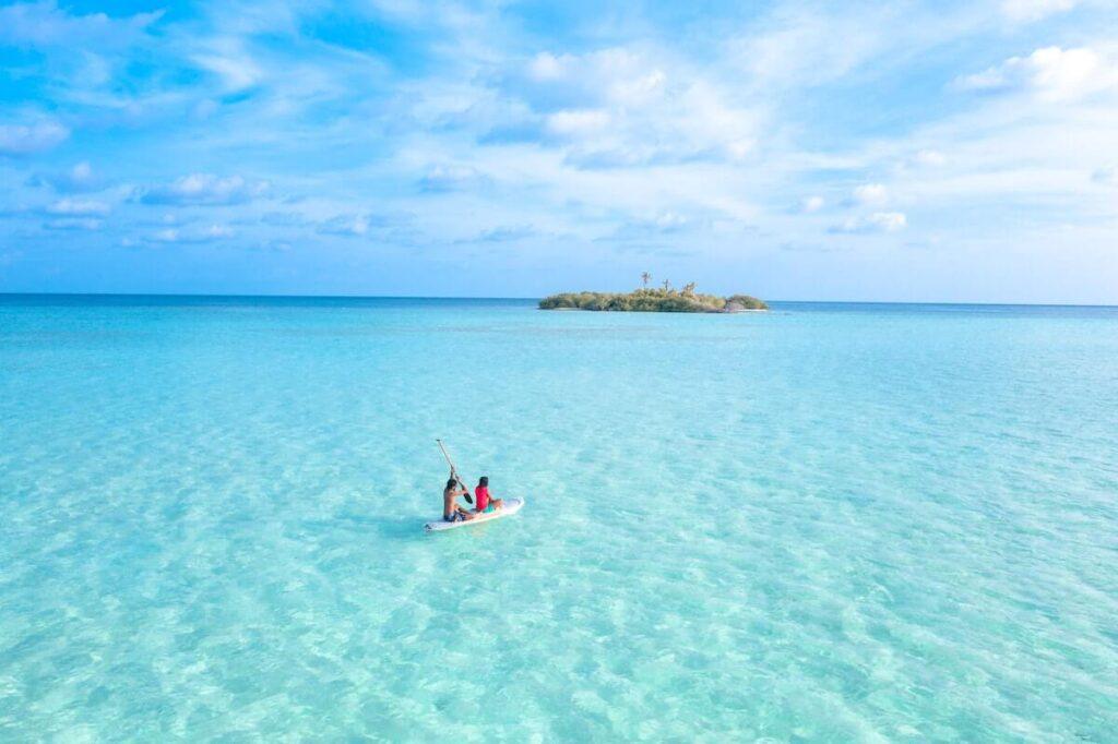 Paddle boarding in small island of Honduras.