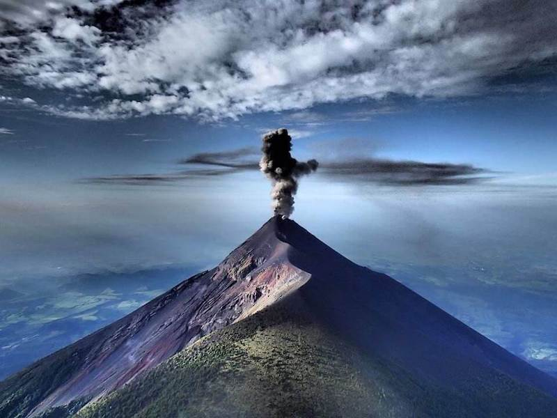 Fascinating view of Volcano de Fuego erupting from the top of the neighbor Volcano Acatenango