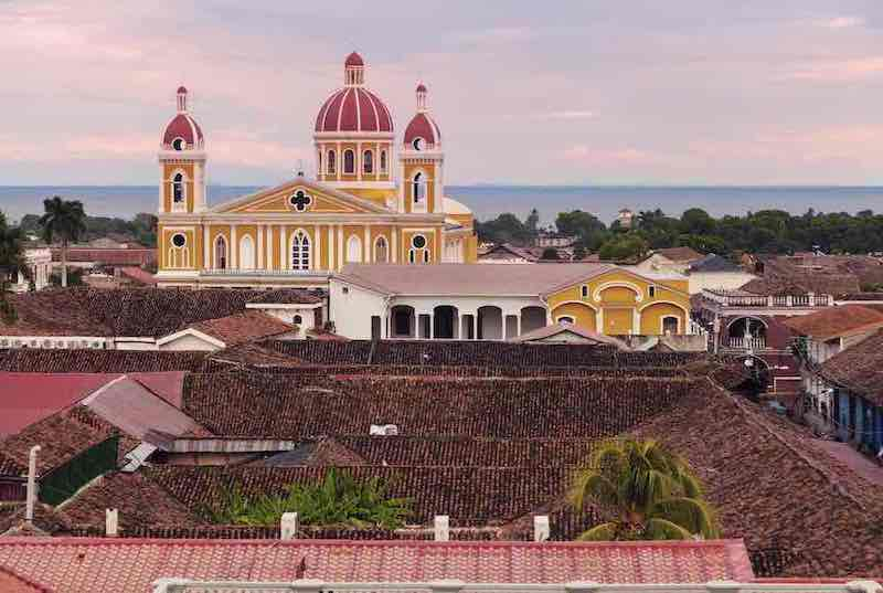 Dazzling panorama of the Cathedral, the colonial city of Granada, and lake Managua.
