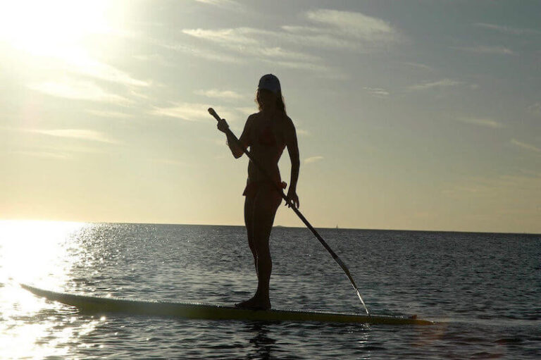 Stand up paddle boarding in the Caribbean Ocean of Honduras.