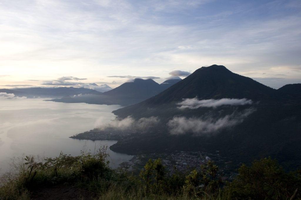 Breathtaking volcanoes surrounding Lake Atitlan during the early morning. Hike to the Nose of the Mayan, Lake Atitlan. Guatemala.